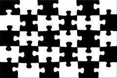 Rompecabezas negro-blanco del ajedrez del fondo. Fotografía de archivo