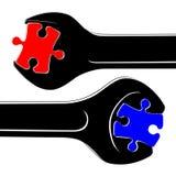 Rompecabezas negros de las llaves inglesas, rojos y azules Foto de archivo