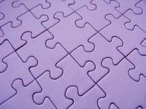 Rompecabezas púrpura Fotos de archivo libres de regalías
