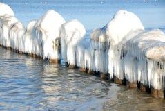 Rompeolas congelado Fotografía de archivo