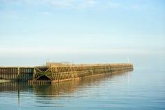Rompeolas del puerto Imagenes de archivo