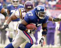 Ron Dayne. Running back Ron Dayne of the New York Giants barrels thru the Minesota Vikings defense at the NFC Championship game. The New York Giants defeated he Stock Photos