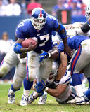 Ron Dayne. Running back Ron Dayne of the New York Giants barrels thru the Minesota Vikings defense at the NFC Championship game. The New York Giants defeated he Stock Photo