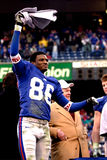 Ron Dixon. Kick Returner Ron Dixon of the New York Giants waves a towel at the NFC Championship game after the New York Giants defeated he Minnesota Vikings to Royalty Free Stock Photography