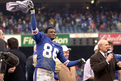 Ron Dixon. Kick Returner Ron Dixon of the New York Giants waves a towel at the NFC Championship game after the New York Giants defeated he Minnesota Vikings to Royalty Free Stock Photos