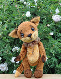Ron fox cub and flowers Stock Photography