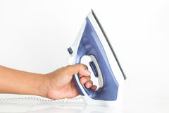 Ron housework ironed electric. Iron housework ironed electric tool clean white background ironing steam housekeeping Stock Image