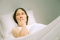 Ron Mueck sculpture. Shown at the GOMA, Brisbane, Australia, In Bed a hyper realistic sculpture of a woman in bed by Ron Mueck,an Australian born, London based Royalty Free Stock Image