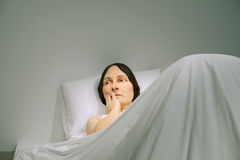 Ron Mueck sculpture. Shown at the GOMA, Brisbane, Australia, In Bed a hyper realistic sculpture of a woman in bed by Ron Mueck,an Australian born, London based Royalty Free Stock Photos