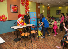 Ronald McDonalds character having party with fans Royalty Free Stock Images