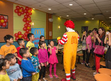 Ronald McDonalds character having party with fans Royalty Free Stock Image