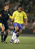 Ronaldinho. Brazilian player Ronaldinho in action during the friendly match between Catalonia vs Brazil at Nou Camp Stadium in Barcelona, Spain. May 25, 2004 Stock Photo