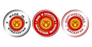 ` Rond de labels fait dans le ` du Kirghizistan avec le drapeau et l'icône de Sun Image stock