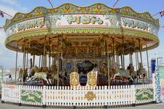Rond point de champ de foire sur Brighton Pier l'angleterre image libre de droits