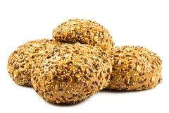 Rond volkorenbrood. s met verschillende zaden. Stock Fotografie