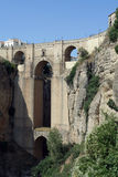 Ronda - Bridge over the Tajo. Ronda - Ancient bridge connecting the old and new parts of the town. The most famous of Spains white villages or Pueblos Blancos Royalty Free Stock Photography