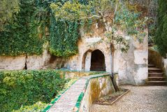 RONDA, SPAIN - FEBRUARY 04, 2014: Entrance to Water Mine at Palacio del Rey Moro in Ronda, a famous white village royalty free stock photo