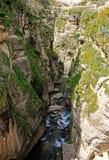 Ronda Spain gorge. Deep gorge  El Tajo in Ronda Spain with stream Stock Photo