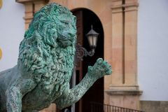 Lion Sculpture from the Hercules Fountain at the Socorro Square. Ronda, Spain. January 19, 2018. Lion Sculpture from the Hercules Fountain at the Socorro Square Royalty Free Stock Images