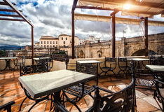 Ronda. Spain. View from the terrace cafe on the Ronda landmark-Puente Nuevo. Province of Malaga, Andalusia, Spain Stock Photos
