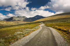 Rondane national park with road and mountains Royalty Free Stock Photography