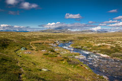 Rondane national park with tent at river Royalty Free Stock Photos