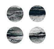Rondas negras y de plata aisladas en blanco Fotografía de archivo
