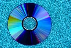 Ronde compact disc op kleine groene stenen royalty-vrije stock afbeelding