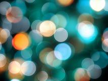 Ronde heldere vage blauwe en oranje ronde lichten op zwarte partijachtergrond stock fotografie