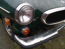 Ronde koplamp op een auto stock afbeeldingen