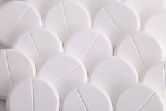 Ronde witte pillenparacetamol aspirinepijnstiller Royalty-vrije Stock Foto