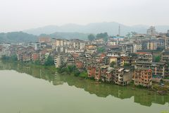 View to the town of Rongshui in Guangxi across the river in Rongshui, China. stock photo