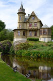 Ronneby park castle in summer season. Ronneby park's small castle with water reflection Royalty Free Stock Images