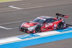 Ronnie Quintarelli van NISMO in Super Definitieve Race 66 van GT Overlappingen bij 20 Stock Afbeelding