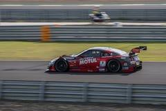 Ronnie Quintarelli van NISMO in Super Definitieve Race 66 van GT Overlappingen bij 20 Stock Foto