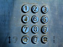 dial pad and buttons of old coin operated street phone stock image