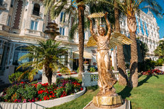 Ronze statue of an angel with a palm branch in Cannes, France Stock Photography
