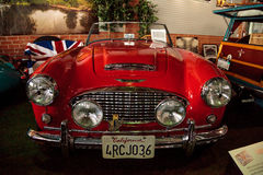 Rood 1959 Austin Healey 300 Open tweepersoonsauto Stock Afbeelding