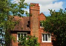 Rood baksteenhuis Stock Foto's