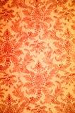 Rood bloempatroon op de muur Stock Afbeelding