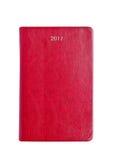 Rood de notaboek van de leer 2017 agenda op wit Stock Foto's