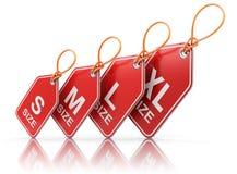 Rood die etiket met kledingsgrootte wordt geplaatst Stock Foto
