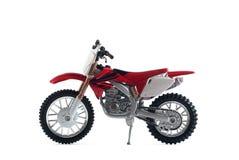 rood die motorfietsstuk speelgoed rood op witte achtergrond wordt geïsoleerd, stock fotografie