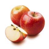 2 rood die stuk van het appelkwart op witte achtergrond wordt geïsoleerd Stock Fotografie