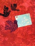 Rood document met vogels Royalty-vrije Stock Foto's
