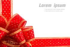 Rood en gouden giftboog en lint Stock Afbeelding
