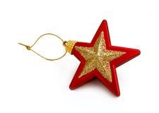 Rood en gouden sterstuk speelgoed Stock Afbeeldingen
