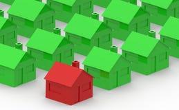 Rood en groen huis op een witte achtergrond royalty-vrije stock afbeelding