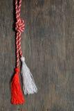 Rood en wit Maart 1 trinket Stock Foto's