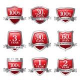 Rood en zilveren achter de waarborgpictogram van het Embleemgeld Royalty-vrije Stock Foto's